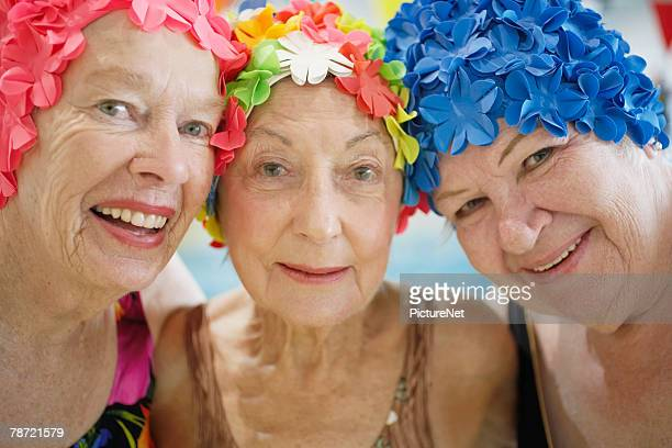 Women Wearing Colorful Bathing Caps