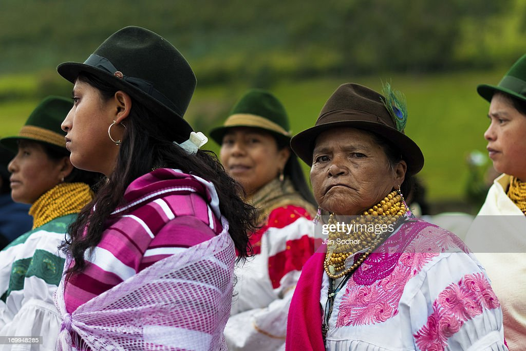 "Women, wearing colorful clothes, watch a procession during the Inti Raymi celebration in the village of Pesillo, Ecuador, 26 June 2010. Inti Raymi, ""Festival of the Sun"" in Quechua language, is an ancient spiritual ceremony held in the Indian regions of the Andes, mainly in Ecuador and Peru. The lively celebration, set by the winter solstice, goes on for various days. The highland Indians, wearing beautiful costumes, dance, drink and sing with no rest. Colorful processions in honor of the God Inti (Sun) pass through the mountain villages giving thanks for the harvest and expressing their deep relation to the Mother Earth (Pachamama)."