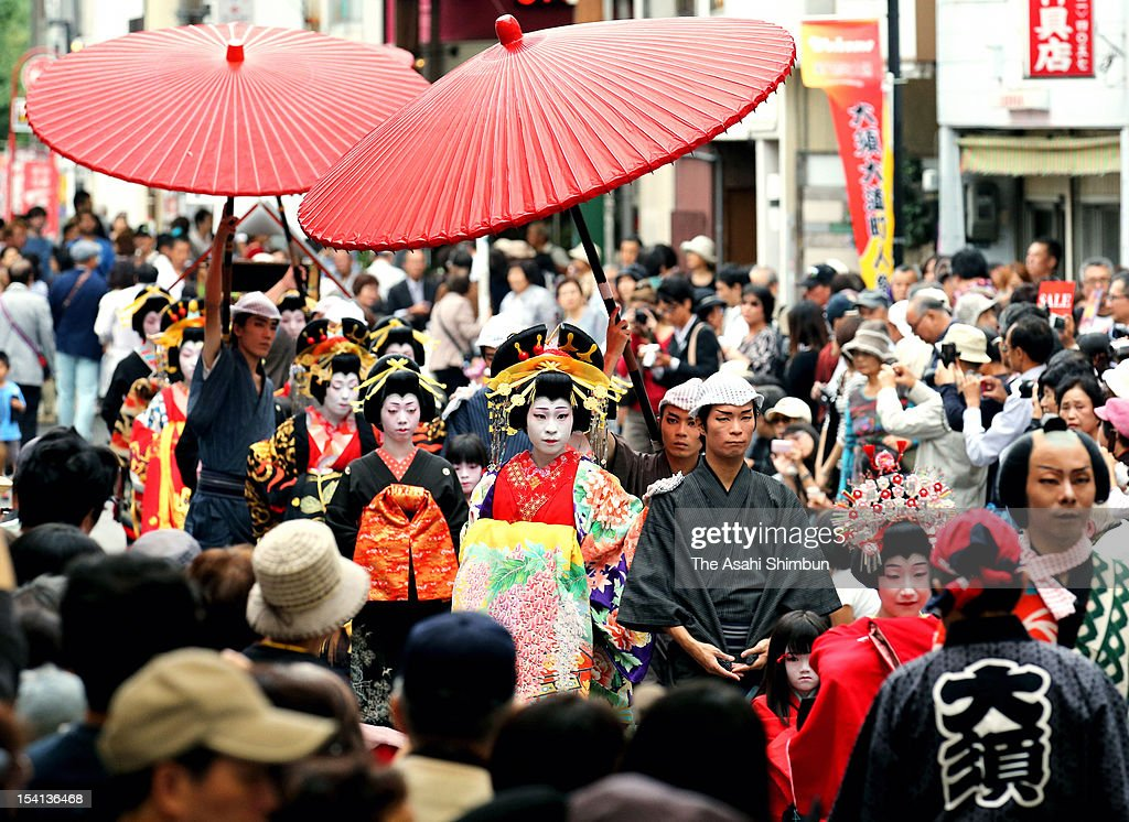 Women wearing costumes of Oiran, courtesans of Edo peirod, march on during Osu Oiran Dochu, as a part of Osu Daido Chonin Matsuri festival on October 13, 2012 in Nagoya, Aichi, Japan.