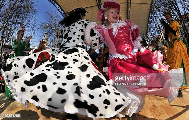 Women wearing decorated dresses dance during the traditional 'Tanz der Marktweiber' on carnival Tuesday March 8 2011 at the Viktualienmarkt market...