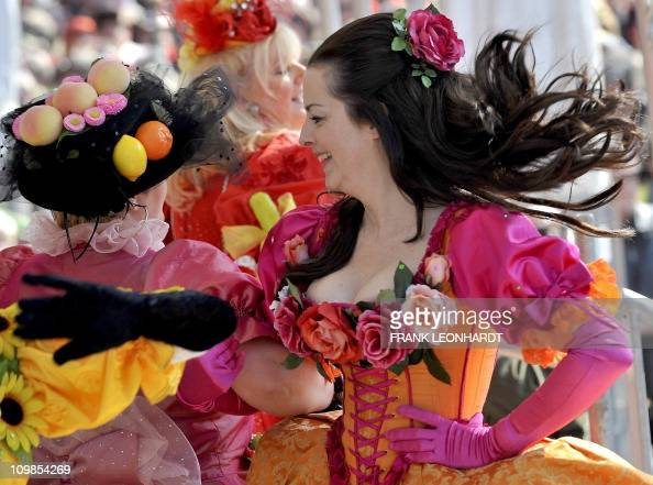 Women wearing dresses decorated with fruit and vegetables dance during the traditional 'Tanz der Marktweiber' on carnival Tuesday March 8 2011 at the...