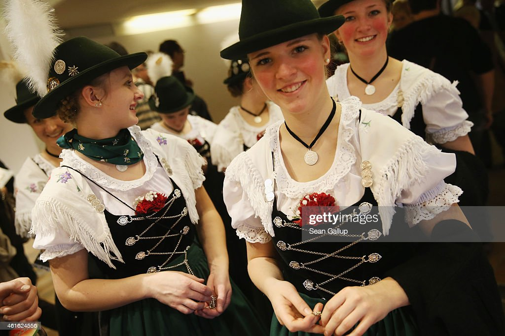 Women wearing folk costumes from the Allgaeu region of southern Bavaria attend the International Green Week agricultural trade fair (Internationale Gruene Woche) on January 16, 2015 in Berlin, Germany. The International Green Week is the world's largest agricultural trade fair and is open to the public from January 16-25.