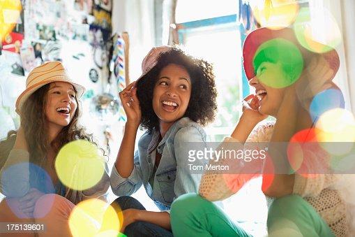 Women wearing hats in bedroom : Stock Photo