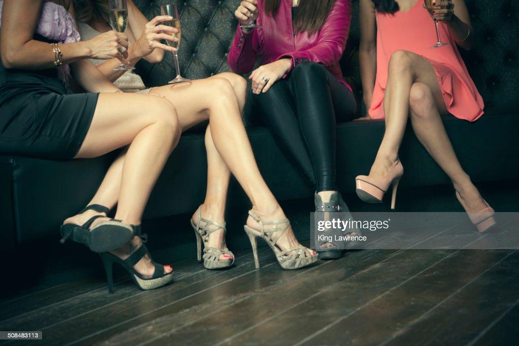 Women wearing high heels in nightclub