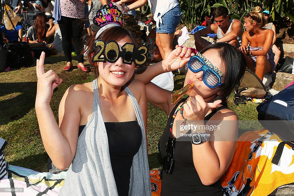 Women wearing New Years themed glasses take up position along the harbour in anticipation of New Years Eve celebrations on Sydney Harbour on December 31, 2012 in Sydney, Australia.