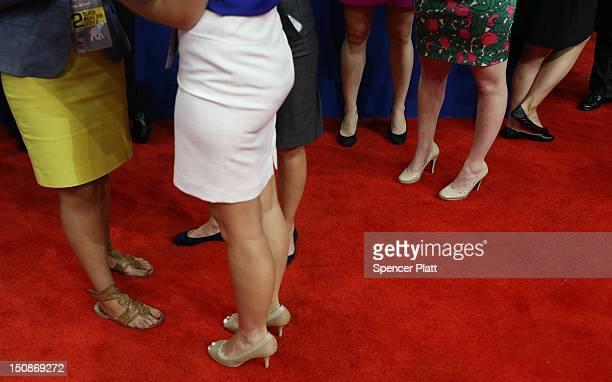 Women wearing skirts and heels stand on the arena floor during the Republican National Convention at the Tampa Bay Times Forum on August 28 2012 in...