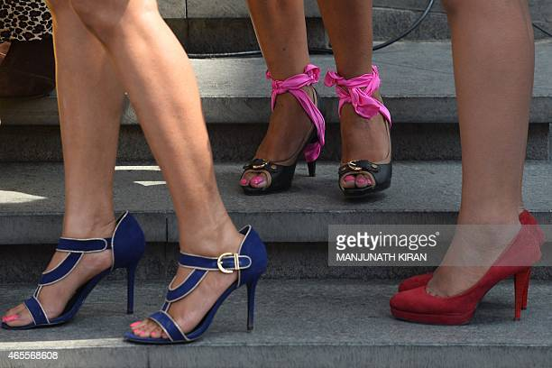 Women wearing stilletos wait to take part in Indias first ever 'Stilleto Run' organised by women's fashion brand Elle on International Womens Day in...