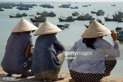 Women Wearing Traditional Ao Dai Hats In Mui Ne, Vietnam