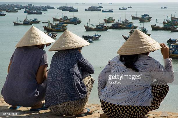 Women Wearing Traditional Ao Dai Hats In Mui Ne, Vietnam