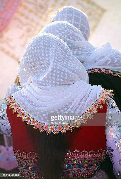 Women wearing traditional Pomak daily dress arrive at the house of bride Fatme Inus to see items of her dowry on display on the first day of twoday...