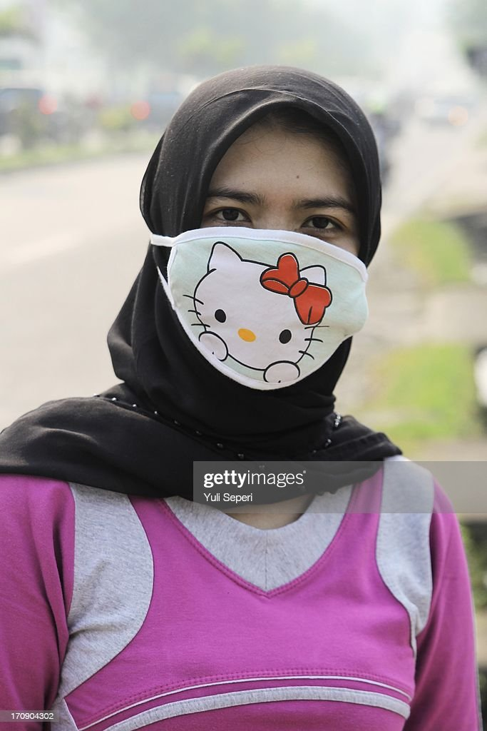 A women wears a face mask to protect herself from haze air pollution on June 20, 2013 in Bintan Island, Indonesia. The haze, which is created by the illegal burning of forestry in Sumatra in order to make way for palm plantations, is enveloping much of Indonesia, Malaysia and Singapore.