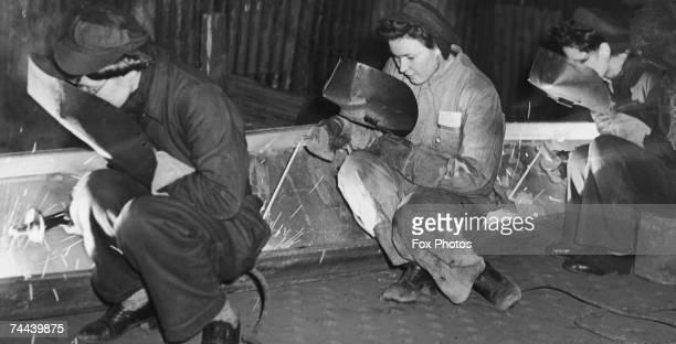 Women welders at work in a British shipyard during World War II 4th February 1944