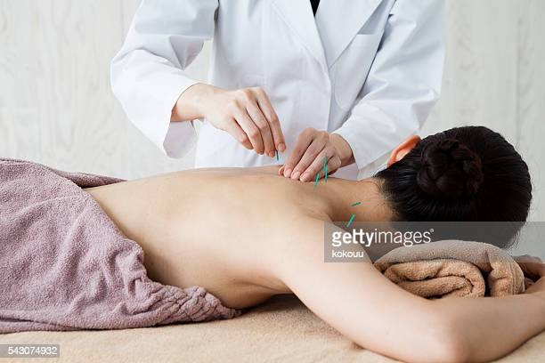 Women who are acupuncture back in the clinic