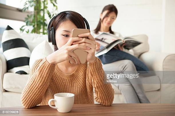 Women who are using smartphones and tablet at home
