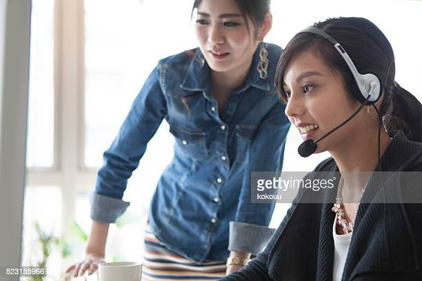 Women who are working in the Customer Center
