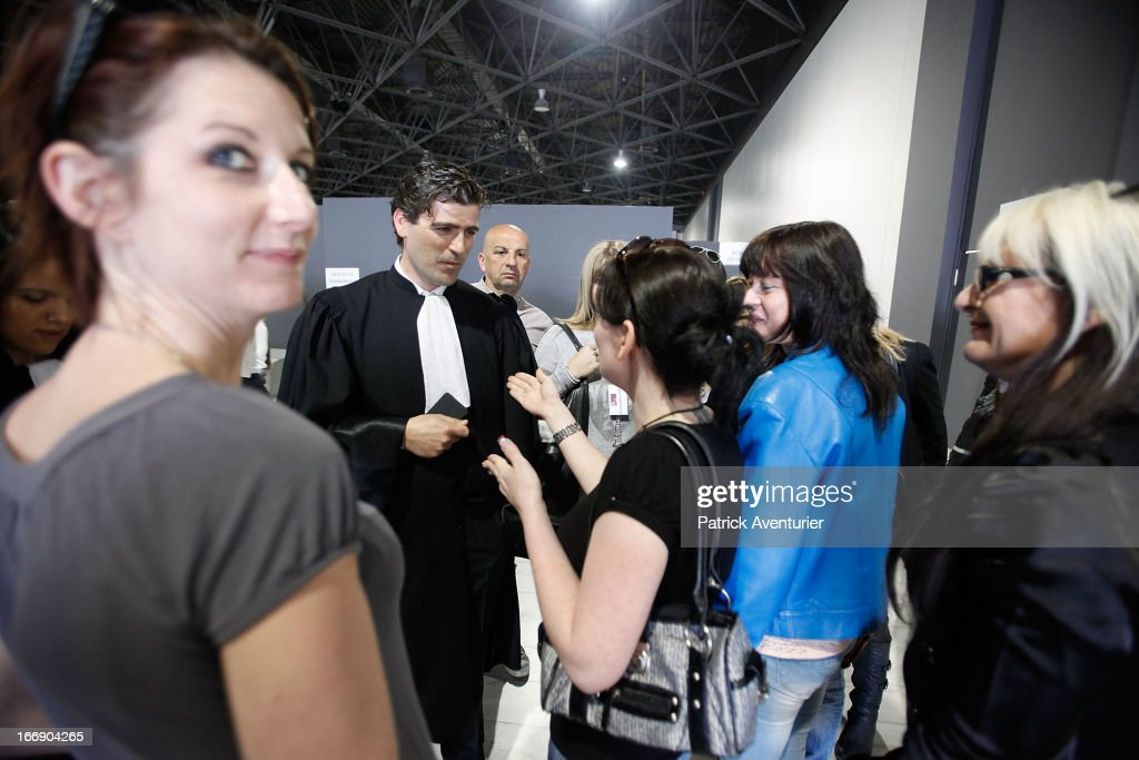 Women who received PIP breast implants speak with plaintiff lawyer Laurent Gaudon outside a courtroom on April 18, 2013 at the courthouse at Parc Chanot in Marseille, France. Jean-Claude Mass and his PIP company are facing fraud charges for allegedly selling 30 000 faulty breast implants in France with non-autorised silicone gel that caused abnormally high rupture rates of its implants.5200 women complained against PIP.