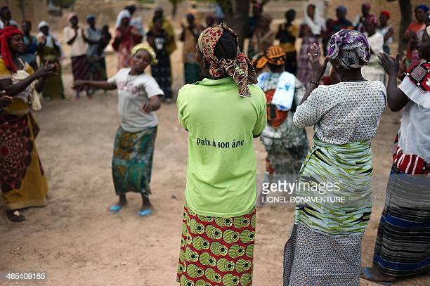 Women who work thanks to a microcrdit program dance during a welcoming ceremony on January 24 2014 in Leo Burkina Faso The French cosmetics company...