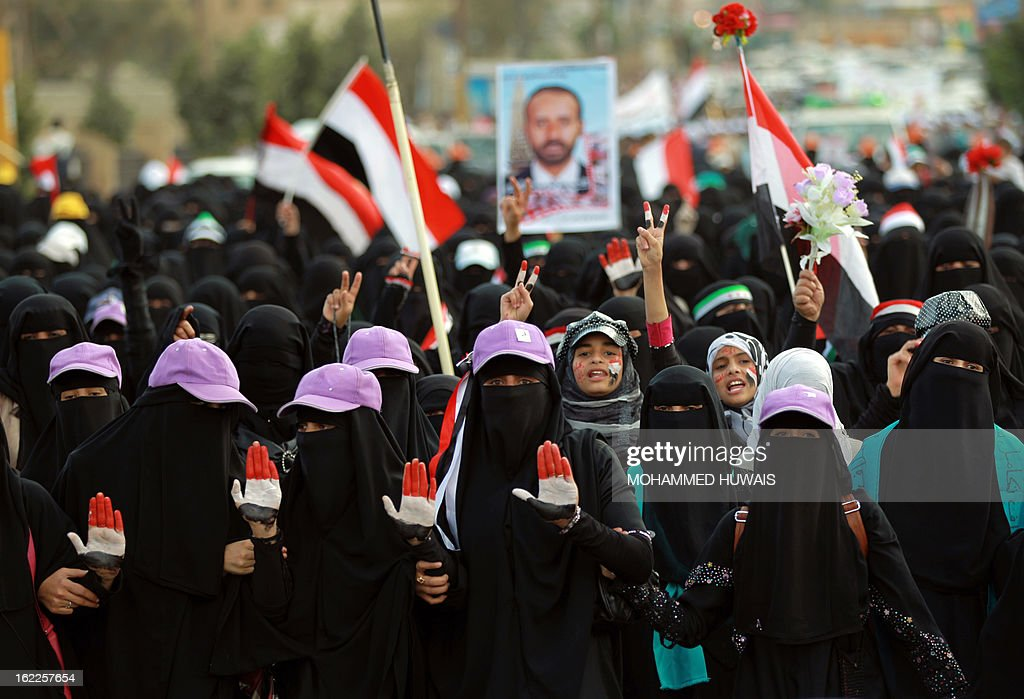 Women, whose hands are painted with Yemen's colours, flash the sign of victory during a rally marking the first anniversary of the ouster of autocratic leader Ali Abdullah Saleh on February 21, 2013 in the Yemeni capital Sanaa. Yemeni police shot dead four people in Aden on Thursday in clashes with protesters calling for southern independence AFP PHOTO/ MOHAMMED HUWAIS