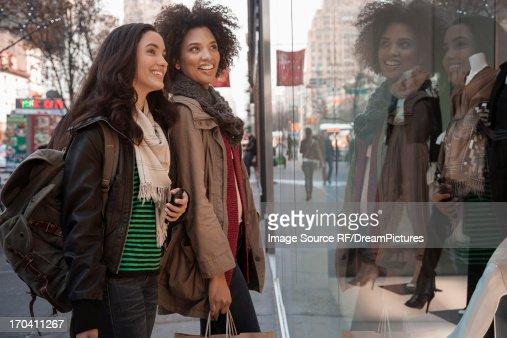Women window shopping on city street : Stock Photo