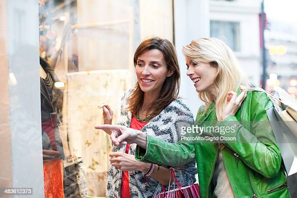 Women window shopping together