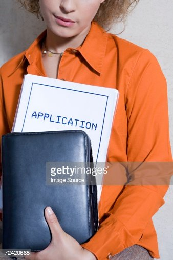 Women with application form : Stock Photo