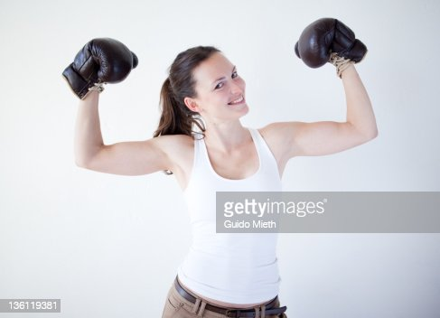 Women with boxing gloves cheering