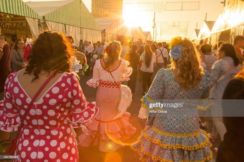 Women with flamenco dress in Feria de Abril.
