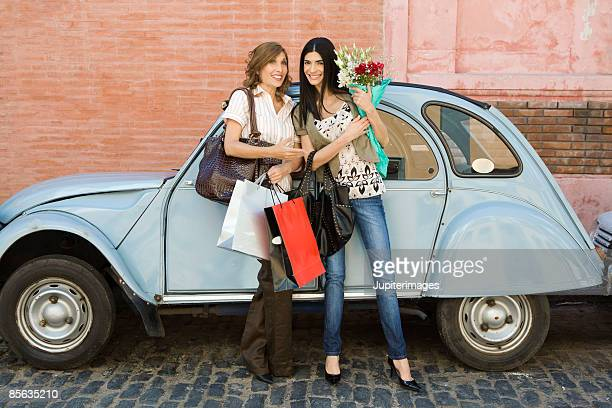 Women with flowers and shopping bags