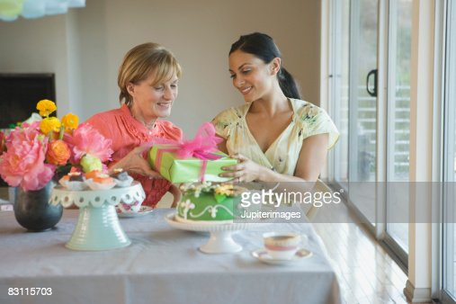 Women with gift at party : Stock Photo
