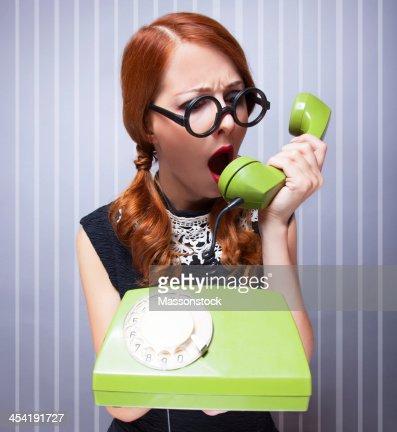 Women with green telephone : Stock Photo