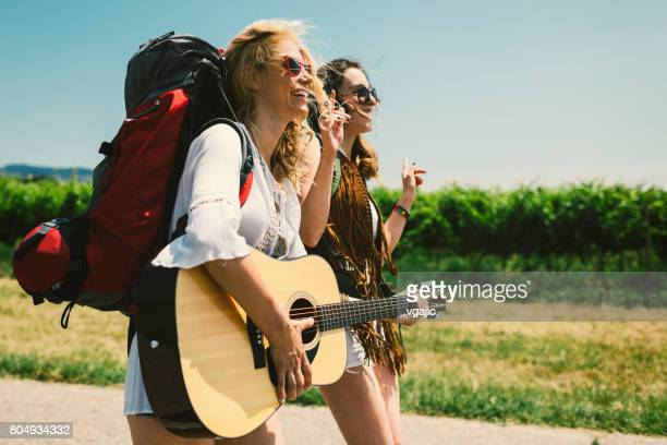 Women with guitar on the road