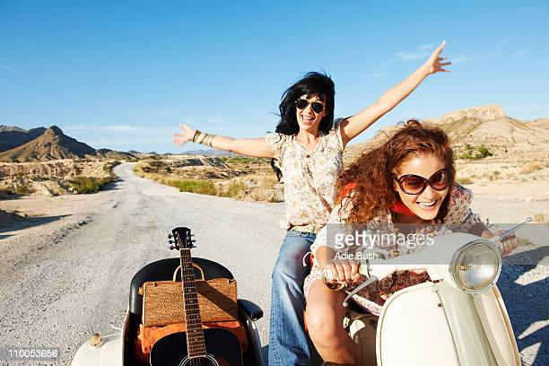 Women with motorbike and sidecar