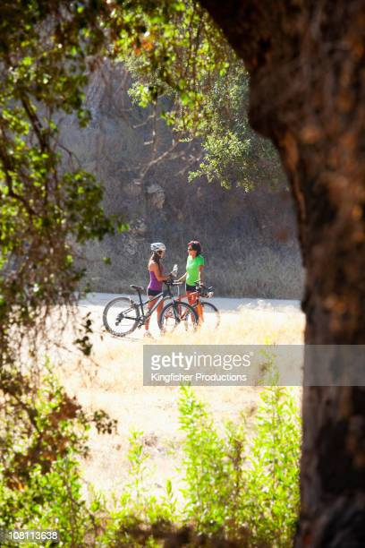 Women with mountain bikes stopping in remote area