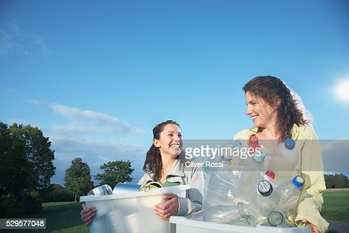 Women with Recycling Bins : Stock Photo