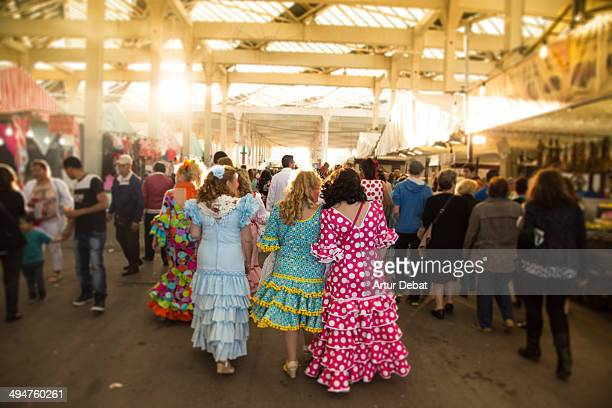 Women with spain flamenco dress in Feria de Abril.