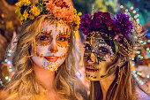 Women with sugar skull makeup at Dia de los Muertos procession