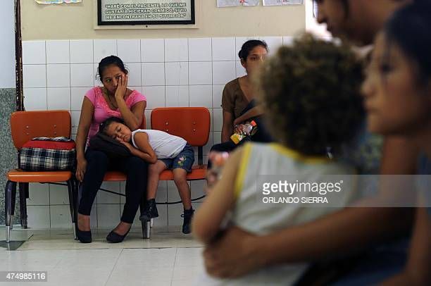 Women with their children infected with dengue or chikungunya wait for medical assistance at the Hospital Materno Infantil in Tegucigalpa on May 28...