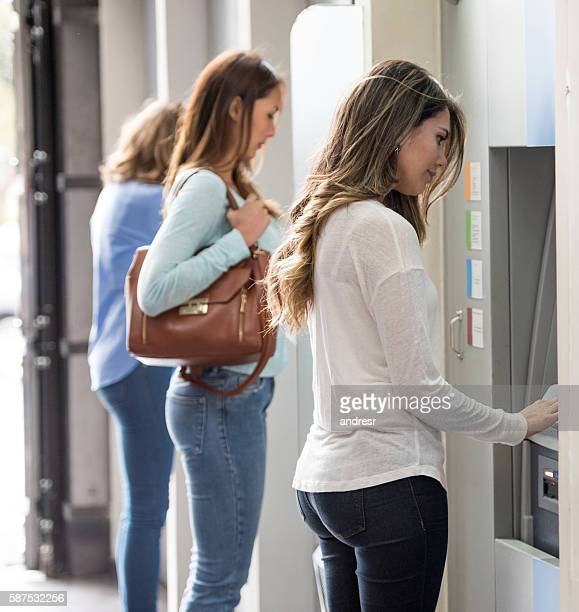Women withdrawing cash at an ATM