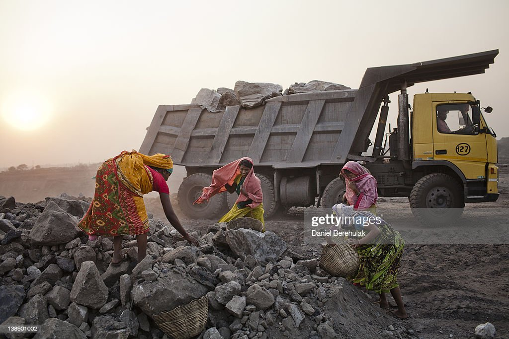 Women work to scavenge coal at a dump site of an open-cast coal mine in the village of Jina Gora on February 09, 2012 near Jharia, India. Villagers in India's Eastern State of Jharkhand scavenge coal illegally from open-cast coal mines to earn a few dollars a day. Claiming that decades old underground burning coal seams threatened the homes of villagers, the government has recently relocated over 2300 families to towns like Belgaria. Villagers claim they were promised schools, hospitals and free utilities for two years, which they have not received. As the world's power needs have increased, so has the total global production of coal, nearly doubling over the last 20 years according to the World Coal Association.