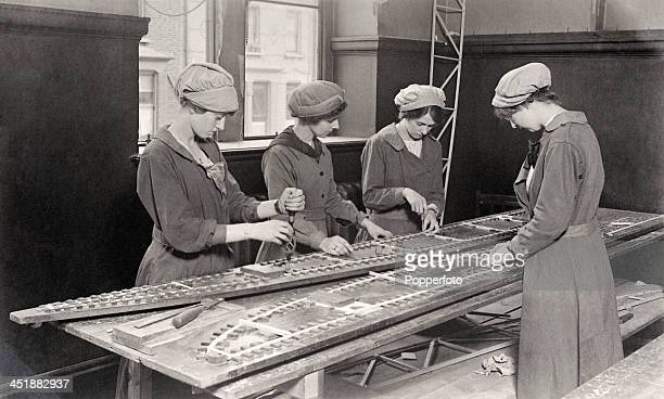 Women workers contributing to the war effort in an aeroplane factory workshop during World War One circa 1915