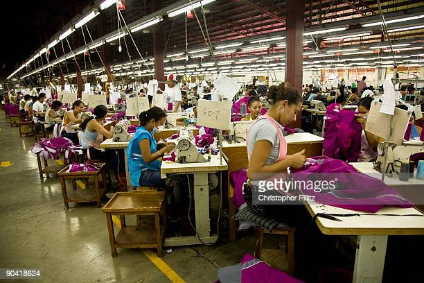 Women workers mass producing clothing for export