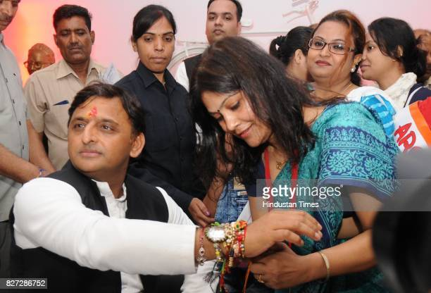 Women workers of Samajwadi Party tying rakhi to former UP Chief Minister Akhilesh Yadav on the occasion of Raksha Bandhan festival at his party...