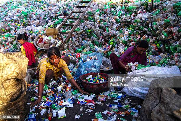 Women workers recycling plastic products mainly plastic bottles in a local factory