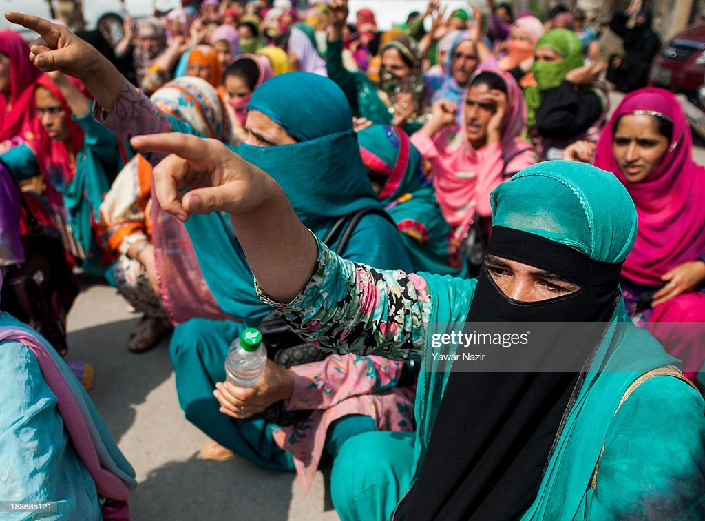 Women workers shout anti-government slogans during a protest against government on October 08, 2013 in Srinagar, the summer capital of Indian administered Kashmir, India. Anganwari Workers and Helpers, who work for child care and development under the Integrated Child Development Services (ICDS), a programme started by the Government of India in 1975 for early childhood care and development, are seeking a hike in monthly salary and regularisation of services.