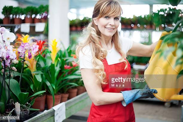 Women working at garden center.