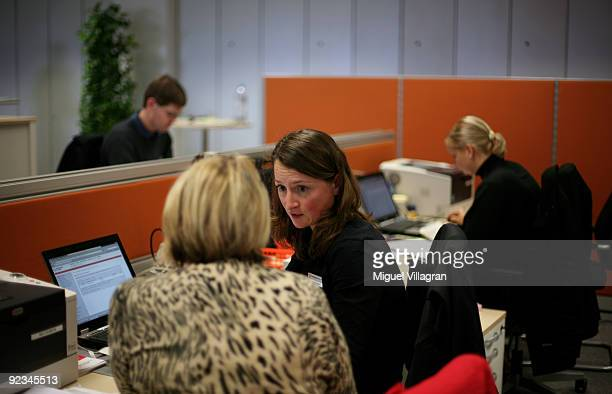 A women working for the governmentrun employment agency 'Agentur fuer Arbeit' talks to a now unemployed Quelle worker on October 26 2009 in Nuremberg...