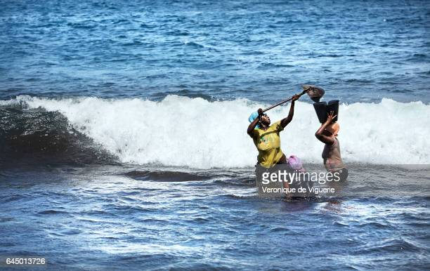 Women working taking out the sand in Ribeira Prata Beach sand is a valuable construction material and in a country with limited economic...