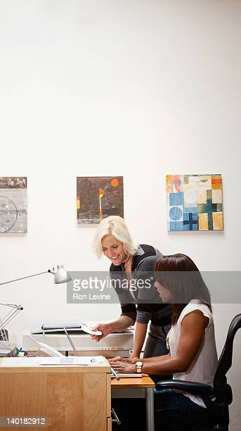 Women working together in a home office