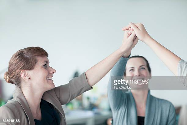 Women working together in teamwork in contemporary design office