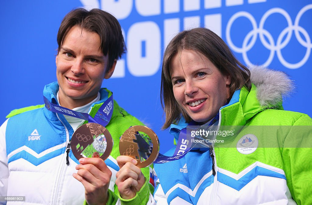 Women's 10 km Pursuit bronze medalist <a gi-track='captionPersonalityLinkClicked' href=/galleries/search?phrase=Teja+Gregorin&family=editorial&specificpeople=876933 ng-click='$event.stopPropagation()'>Teja Gregorin</a> (L) of Slovenia and Ladies' Sprint Free bronze medalist <a gi-track='captionPersonalityLinkClicked' href=/galleries/search?phrase=Vesna+Fabjan&family=editorial&specificpeople=817752 ng-click='$event.stopPropagation()'>Vesna Fabjan</a> of Slovenia celebrate during the medal ceremony on day five of the Sochi 2014 Winter Olympics at Medals Plaza on February 12, 2014 in Sochi, Russia.